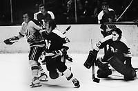 Seals vs North stars 1972. Seals Reggie Leach and North Stars Dennie O'Brien and goalie Cesare Maniago.<br />(photo/Ron Riesterer)
