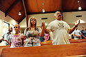 LAFITTE, LA - JUNE 20:  From left to right, Holly Casso, Christina Casso and Jay Casso pray at St. Anthony Church on a day designated a day of prayer in response to the Gulf oil spill, June 20, 2010 in Lafitte.   (Photo by Cheryl Gerber/Getty Images).
