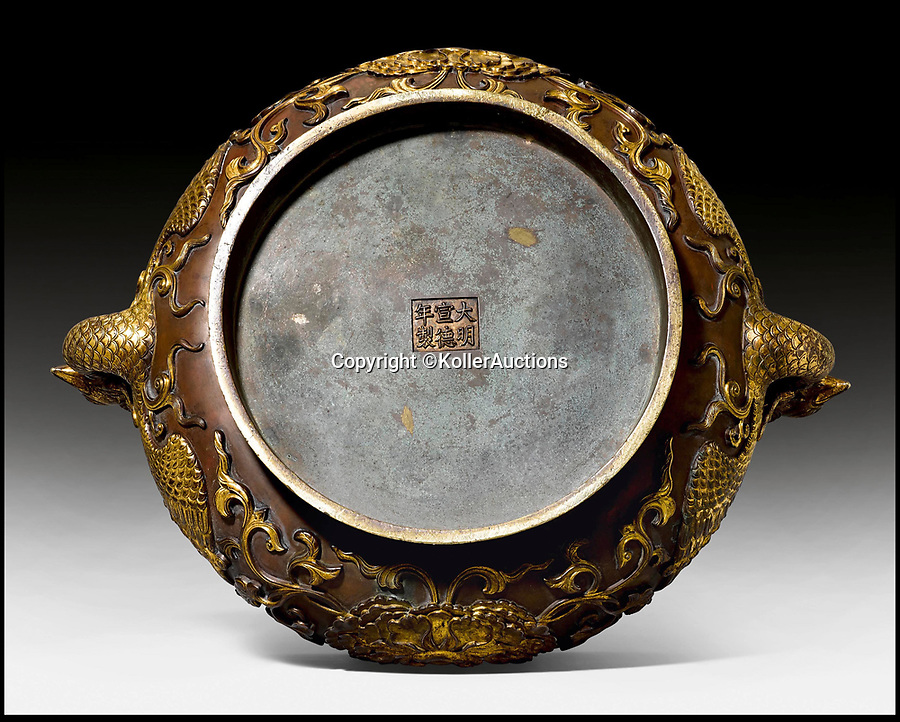 BNPS.co.uk (01202 558833)<br /> Pic: KollerAuctions/BNPS<br /> <br /> Qing dynasty mark.<br /> <br /> Smashed It! - £3.8 million paid for 300 year old Chinese bronze used to keep tennis balls in.<br /> <br /> The incense burning censer, decorated with auspicious peony and phoenix designs, was thought by its owners to be a 19th century copy.<br /> <br /> It was only when the family invited Asian art specialist Regi Preiswerk to their home to look at some other antiques that its true potential was spotted.<br /> <br /> The 2ft wide urn weighing a hefty 48 lbs was made for a Qing Emperor in the 18th century.