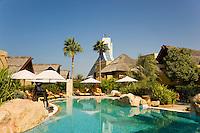 Dubai.  Pool and gardens at exclusive villa development, Beit al Bahar, attached to Jumeirah Beach Hotel..