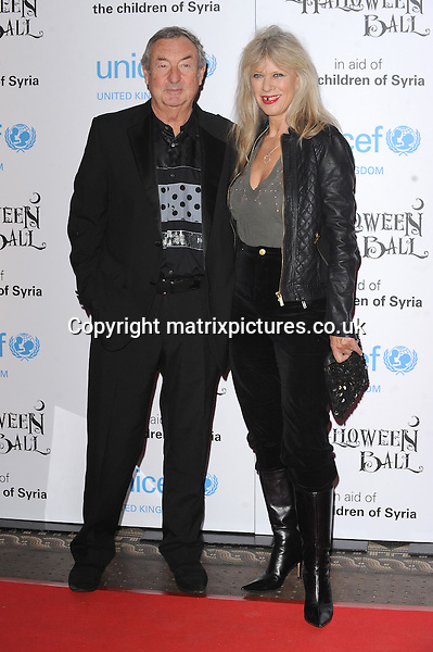 NON EXCLUSIVE PICTURE: PAUL TREADWAY / MATRIXPICTURES.CO.UK<br /> PLEASE CREDIT ALL USES<br /> <br /> WORLD RIGHTS<br /> <br /> English &quot;Pink Floyd&quot; drummer Nick Mason and wife Annette Mason attending the UNICEF Halloween Ball at London's One Mayfair.<br /> <br /> OCTOBER 31st 2013<br /> <br /> REF: PTY 137081