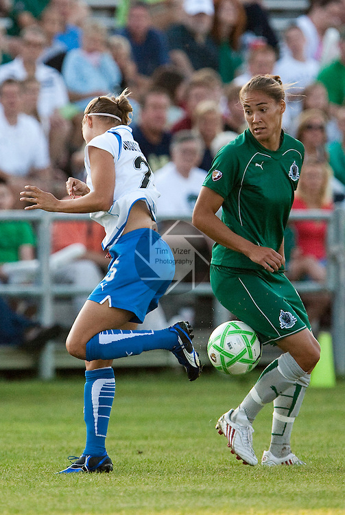 August 1 2009       The ball landed between Breakers player Nancy Augustyniak Goffi (25, left) and Athletica player Niki Cross (19) during first half action.   The St. Louis Athletica of the Women's Professional Soccer league hosted the Boston Breakers on Saturday August 1, 2009 at the Anheuser Busch Soccer Park in Fenton, Missouri.   The Athletica won, 1-0, and clinched a spot in the post-season playoffs...            *******EDITORIAL USE ONLY*******