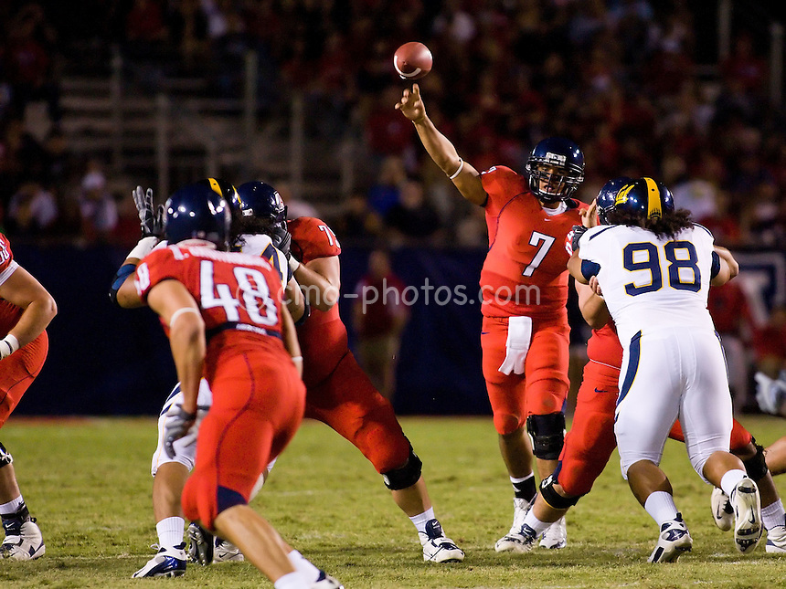 Oct 18, 2008; Tucson, AZ, USA; Arizona Wildcats quarterback Willie Tuitama (7) throws a pass to Arizona Wildcats tight end Rob Gronkowski (48) while California Golden Bears defensive tackle Mika Kane (98) engages an offensive lineman in the first half of a game at Arizona Stadium.
