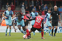 Lee Molyneux (R) of Morecambe tackles Marcus Bean (L) of Wycombe Wanderers during the Sky Bet League 2 match between Morecambe and Wycombe Wanderers at the Globe Arena, Morecambe, England on 29 April 2017. Photo by Stephen Gaunt / PRiME Media Images.