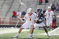 College Park, MD - February 18, 2017: Maryland Terrapins Matt Rambo (1) holds of a High Point Panthers defender during game between High Point and Maryland at  Capital One Field at Maryland Stadium in College Park, MD.  (Photo by Elliott Brown/Media Images International)