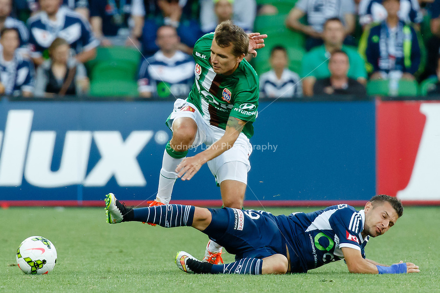Joel GRIFFITHS (9) of the Jets and Kosta BARBAROUSES of the Victory fight for the ball in round 12 A-League match between Melbourne Victory and Newcastle Jets at AAMI Park in Melbourne, Australia during the 2014/2015 Australian A-League season. Melbourne def Newcastle 1-0