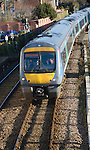 Class 170 turbostar diesel train on rail tracks, Woodbridge, Suffolk, England