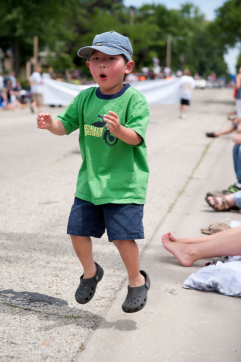 Holden Miller, 4, jumps for joy during a July Fourth holiday parade in rural East Troy, Wis., on July 3, 2011.