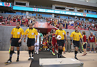Officials and players walk onto the filed before a game against Real Salt Lake and D.C. United at the U.S. Open Cup Final on October  1, 2013 at Rio Tinto Stadium in Sandy, Utah.