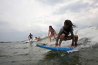 ROCKAWAY, NY - JULY 23 AND 24: People surfing and enjoying the summer activities at Rockaway Beach in Queens, NY. (Photo by Landon Nordeman)