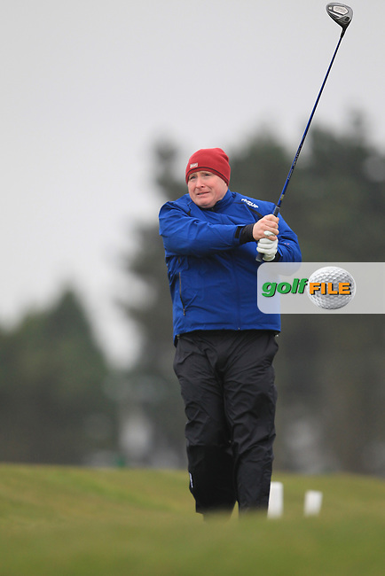 Dominic Cribbon (Co. Meath) on the 1st teeing off in the Hilary golf society in Co Louth Golf Club 24/3/13.Picture: Fran Caffrey / www.golffile.ie ..