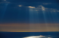 Beautiful blue sky, clouds, sun ray and ocean
