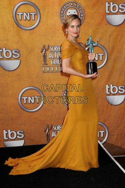 DIANE KRUGER .16th Annual Screen Actors Guild Awards - Press Room held at The Shrine Auditorium, Los Angeles, California, USA, 23rd January 2010..SAG SAGs full length award winner trophy mustard yellow long maxi dress train off the one shoulder .CAP/ADM/BP.©Byron Purvis/Admedia/Capital Pictures