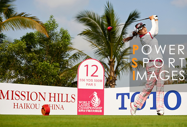 Players in action during the first day of the World Ladies Championship at the Mission Hills Haikou Sandbelt Trails course on 7 March 2013 in Hainan island, China . Photo by Manuel Queimadelos / The Power of Sport Images
