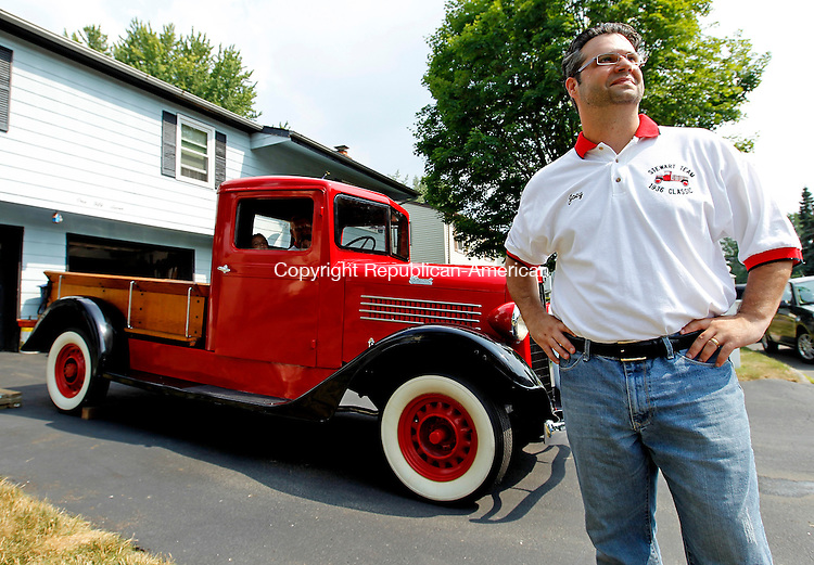 Waterbury, CT-07, July 2010-070710CM04 Joseph Del Carmine, of Waterbury, along with his father-in-law, Nason Maxwell recently had this 1936 Stewart truck restored. The vintage truck was purchased in 1982 by Maxwell.  Prior to the purchase, it was used to transport milk from a farm in Watertown to a factory for processing.  --Christopher Massa Republican-American