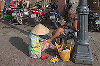 Pedicure in the street of Saigon or in Vietnamese Ho Chi Minh City where old and new architecture mix in harmony. The bustling Metropolis of South Vietnam.