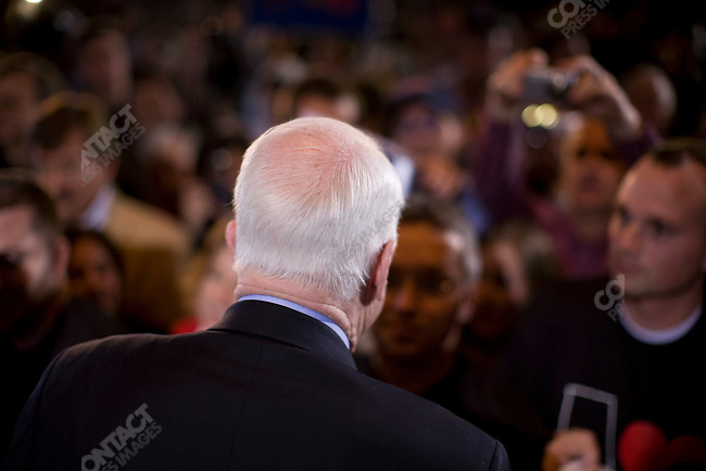 """Senator John McCain (R-AZ), potential Republican presidential candidate, and his wife, Cindy, attend a campaign rally packed with supporters in a push for """"Super Tuesday"""" votes. Birmingham, Alabama, February 2, 2008."""