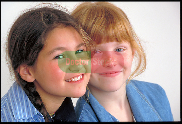 portrait of two young smiling girls