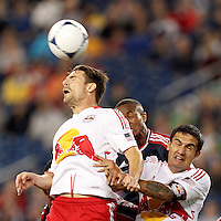 Ball misses New York Red Bulls defender Heath Pearce (3) and is headed by New England Revolution defender Darrius Barnes (25) for the tieing goal. New York Red Bulls forward Tim Cahill (17).  Despite a red-card man advantage, in a Major League Soccer (MLS) match, the New England Revolution tied New York Red Bulls, 1-1, at Gillette Stadium on September 22, 2012.