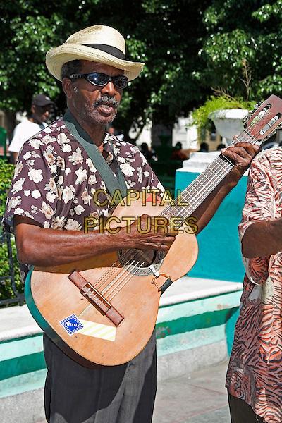 Guitarist in traditional Cuban band, Parque Cespedes, Santiago de Cuba, Cuba