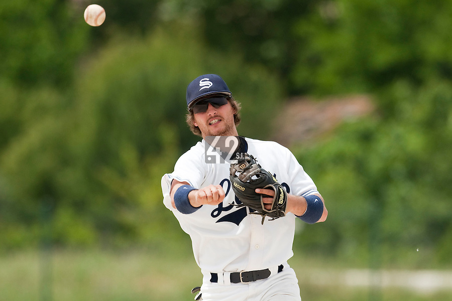 21 May 2009: Romain Scott-Martinez throws a ball to first base during the 2009 challenge de France, a tournament with the best French baseball teams - all eight elite league clubs - to determine a spot in the European Cup next year, at Montpellier, France.
