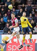 2nd February 2020; Turf Moor, Burnley, Lanchashire, England; English Premier League Football, Burnley versus Arsenal; James Tarkowski of Burnley wins the aeriel ball against Gabriel Martinelli of Arsenal