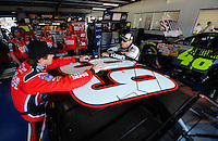 Oct 3, 2008; Talladega, AL, USA; NASCAR Sprint Cup Series driver Carl Edwards (left) talks with Jimmie Johnson during practice for the Amp Energy 500 at the Talladega Superspeedway. Mandatory Credit: Mark J. Rebilas-