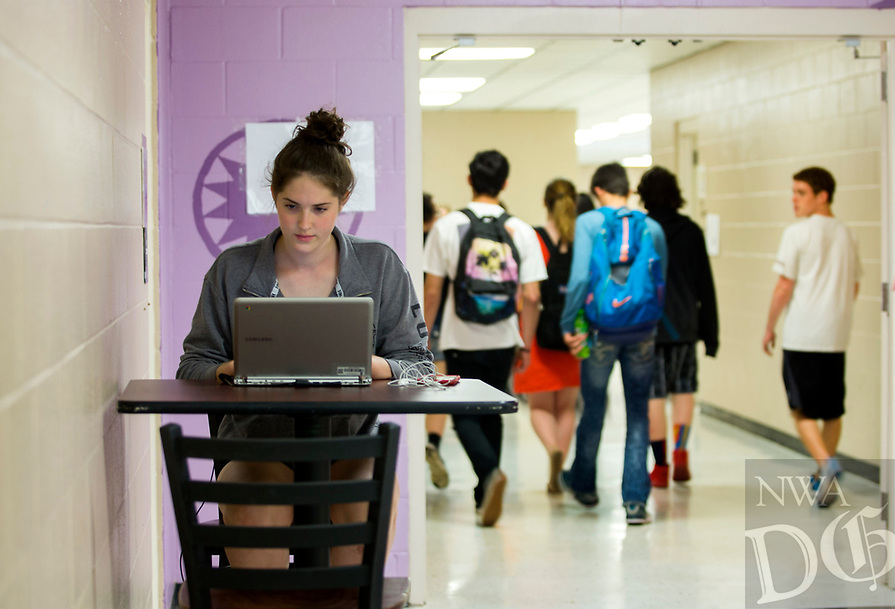 NWA Democrat-Gazette/JASON IVESTER<br /> Kieleigh (cq) Williams, Pea Rige junior, works on her computer Wednesday, May 17, 2017, in the halls of Pea Ridge High School. Voters in the district voted against a 5.1 millage increase.