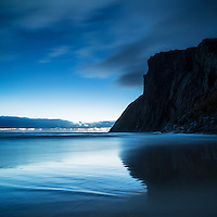 Dramatic cliffs of Ryten silhoutted against evening twilight at Kvalvika beach, Lofoten Islands, Norway