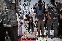 In this Saturday, Jul. 06, 2013 photo, members of the Muslim Brotherhood attend the midday praying at the camping in the Cairo University in Egypt. (Photo/Narciso Contreras).