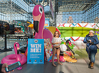 A model in a bikini on a cold winter's day promotes BigMouth toy products at the 113th North American International Toy Fair in the Jacob Javits Convention center in New York on Sunday, February 14, 2016. Temperatures in Central Park reached a record minus 1 degree Fahrenheit breaking the record set in 1916.(© Richard B. Levine)