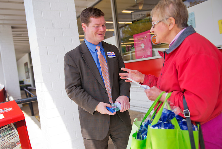 UNITED STATES - APRIL 22: Patrick Mara, D.C. Council at-large candidate, talks with Joan Murphy of Glover Park, outside of the Safeway in Tenleytown. (Photo By Tom Williams/CQ Roll Call)