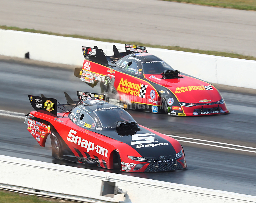 Sep 4, 2017; Clermont, IN, USA; NHRA funny car driver Cruz Pedregon (near) races alongside Courtney Force during the US Nationals at Lucas Oil Raceway. Mandatory Credit: Mark J. Rebilas-USA TODAY Sports