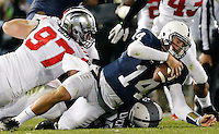 Ohio State Buckeyes defensive lineman Joey Bosa (97) sacks Penn State quarterback Christian Hackenberg (14) in the second overtime  of their game at Beaver Stadium in State College, PA on October 25, 2014. (Columbus Dispatch photo by Brooke LaValley)