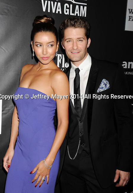 HOLLYWOOD, CA- OCTOBER 29: Actor Matthew Morrison (R) and Renee Puente attend amfAR LA Inspiration Gala honoring Tom Ford at Milk Studios on October 29, 2014 in Hollywood, California.