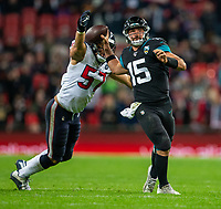3rd November 2019; Wembley Stadium, London, England; National Football League, Houston Texans versus Jacksonville Jaguars; Quarterback Gardner Minshew II of Jacksonville Jaguars about to be tackled by Linebacker Brennan Scarlett of Houston Texans - Editorial Use