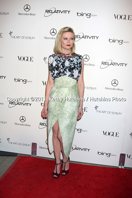 LOS ANGELES - JAN 15:  Kirsten Dunst arrives at the Art Of Elysium 'Heaven' Gala 2011 at The California Science Center Exposition Park  on January 15, 2011 in Los Angeles, CA