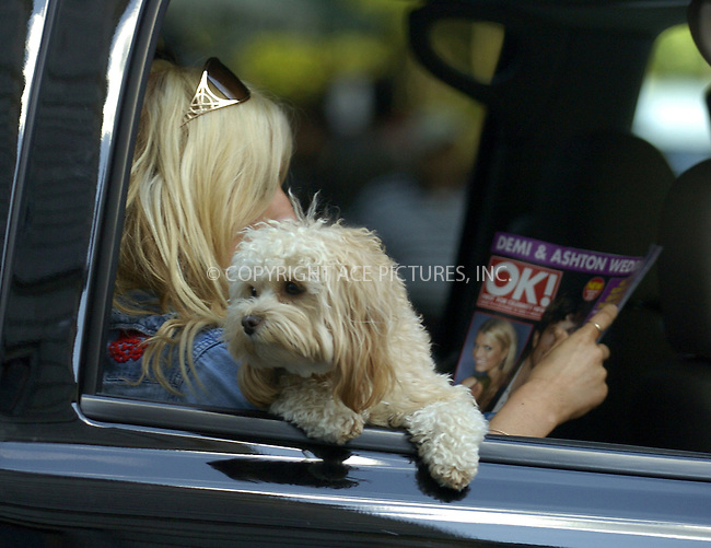 WWW.ACEPIXS.COM ** ** ** ....NEW YORK, SEPTEMBER 28, 2005....Jessica simpson sits in her car reading an issue of OK! Magazine outside her midtown hotel.....Please byline: Philip Vaughan -- ACE PICTURES... *** ***  ..Ace Pictures, Inc:  ..Craig Ashby (212) 243-8787..e-mail: picturedesk@acepixs.com..web: http://www.acepixs.com