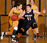 JANUARY 31, 2015 -- Chelsey Biegler #22 of Black Hills State drives on Emily Hartegan #41 of Metro State during their Rocky Mountain Athletic Conference women's basketball game Saturday evening at the Donald E. Young Center in Spearfish, S.D.  (Photo by Dick Carlson/Inertia)