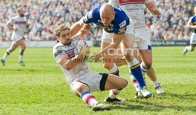 Picture by Allan McKenzie/SWpix.com - 06/04/2015 - Rugby League - First Utility Super League - Leeds Rhinos v Wakefield Trinity Wildcats - Headingley Carnegie Stadium, Leeds, England - Wakefield's Jarrod Sammut is tackled by Leeds's Carl Ablett.