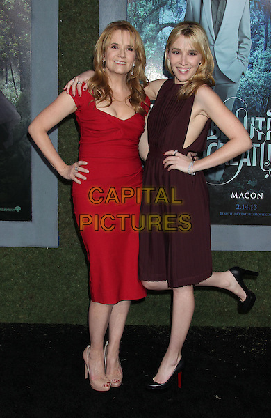 "Lea Thompson, Maddie Deutch.""Beautiful Creatures"" Los Angeles Premiere held at the TCL Chinese Theatre, Hollywood, California, USA, .6th February 2013..full length red dress burgundy maroon dress sleeveless arm arms around hand on hip leg standing on one foot .CAP/ADM/RE.©Russ Elliot/AdMedia/Capital Pictures."