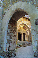 Church of St. Pierre viewed through fortified arch at  Carennac in the Dordogne Valley of France, AGPix_0204.