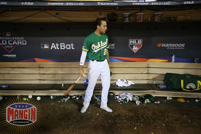 OAKLAND, CA - OCTOBER 02:  Matt Olson #28 of the Oakland Athletics sits in the dugout after the American League Wild Card stands against the Tampa Bay Rays at RingCentral Coliseum on Wednesday, October 2, 2019 in Oakland, California. (Photo by Brad Mangin)