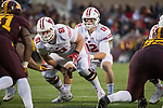 Wisconsin Badgers quarterback Alex Hornibrook (12) receives the ball from center Tyler Biadasz (61) during an NCAA College Big Ten Conference football game against the Minnesota Golden Gophers Saturday, November 25, 2017, in Minneapolis, Minnesota. The Badgers won 31-0. (Photo by David Stluka)