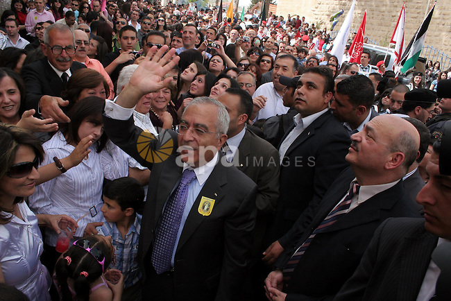 Palestinian Prime Minister Salam Fayyad takes part in the celebrations during his visit to the town of Beit Sahour near the West Bank city of Bethlehem on 03 April 2010. Christians around the world are marking the Holy Week, commemorating the crucifixion of Jesus Christ, leading up to his resurrection on Easter. Photo by Najeh Hashlamoun