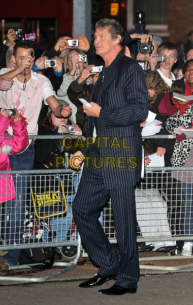 DAVID HASSELHOFF .Arrivals - 2009 Brit Awards, Earls Court, London, England, February 18th 2009..brits full length blue navy pinstripe suit cameras profile side .CAP/PL.©Phil Loftus/Capital Pictures