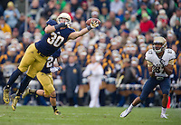 Linebacker Ben Councell (30) breaks up a pass intended for Navy Midshipmen wide receiver Shawn Lynch (87).