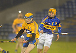 Tipperary's Shane Mc Grath looks on as Seadna Morey gathers posession. Photograph by Declan Monaghan