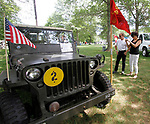 WOODBURY, CT - 06 AUGUST 2017 - 080617JW05.jpg -- Bruce and Michelle Porzelt of Southbury admire the 1943 Willys military jeep of Charles Grondona Sunday afternoon during a U.S. Military History timeline event put on by Ray Manzi ay Hollow Park. Jonathan Wilcox Republican-American