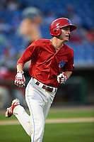 Clearwater Threshers center fielder Carlos Tocci (15) runs to first during a game against the Charlotte Stone Crabs on April 12, 2016 at Bright House Field in Clearwater, Florida.  Charlotte defeated Clearwater 2-1.  (Mike Janes/Four Seam Images)
